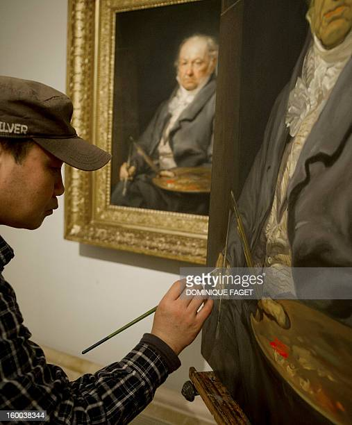 Chinese painter Sun Wengong works on his painting a copy of Vicente Lopez's painting El pintor Francisco de Goya at the Prado Museum in Madrid on...
