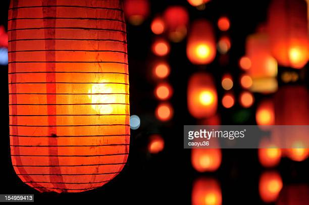Chinese paper lanterns hanging and lit