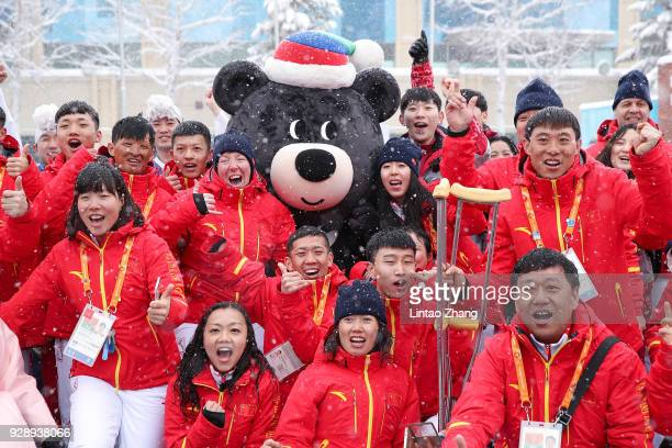 Chinese Paralympic team posing for photographers during the Welcoming Ceremony at the PyeongChang Olympic Village ahead of the PyeongChang 2018...