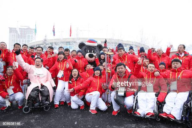 Chinese Paralympic team with village mayor Park EunSoo posing for photographers during the Welcoming Ceremony at the PyeongChang Olympic Village...