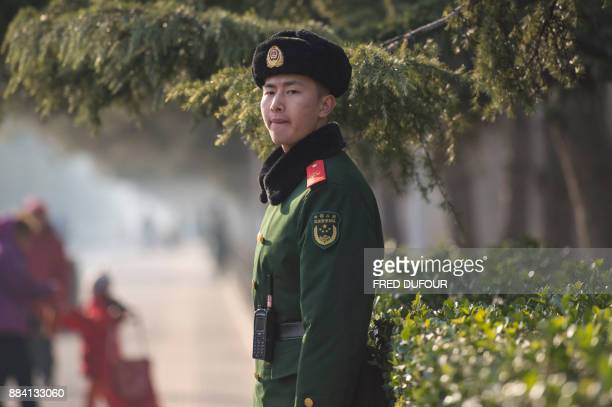 A Chinese Paramilitary guard stands during the CPC in dialogue with world political parties highlevel meeting at the Diaoyutai State Guesthouse on...