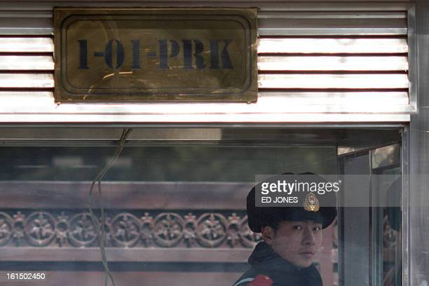 A Chinese paramilitary guard stands in a booth beneath a PRK sign outside the North Korean embassy in Beijing on February 12 2013 North Korea's...