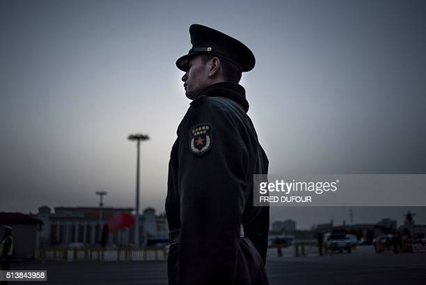 Chinese paramilitary guard stands outside the Great Hall of the People before the opening ceremony of the National People's Congress in Beijing on...