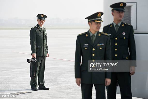 Chinese paramilitary officer standing on the tarmac of Hangzhou airport during the G20 Summit on September 3 2016 in Hangzhou China