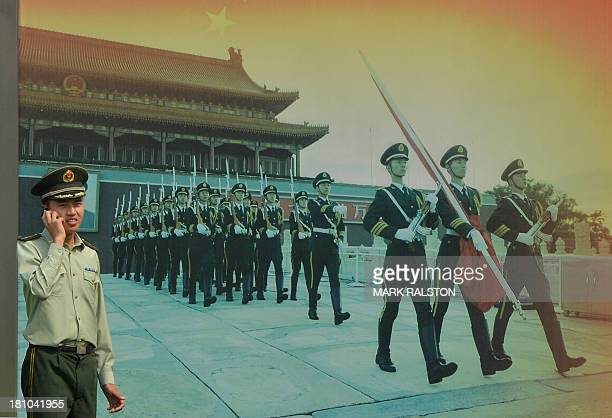 A Chinese paramilitary officer talks on a phone outside his barracks in Beijing on September 19 2013 Fallen Chinese politician Bo Xilai has written a...