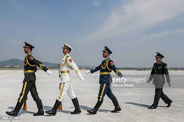Chinese paramilitary officers parade on the tarmac of Hangzhou airport during the G20 Summit on September 3 2016 in Hangzhou China