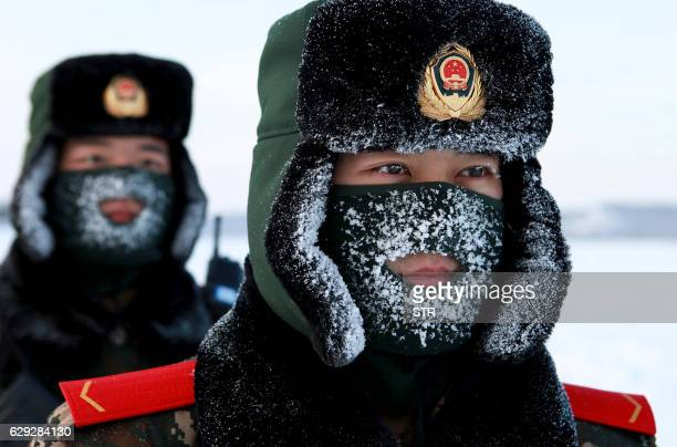 TOPSHOT Chinese paramilitary police border guards train in the snow at Mohe County in China's northeast Heilongjiang province on the border with...