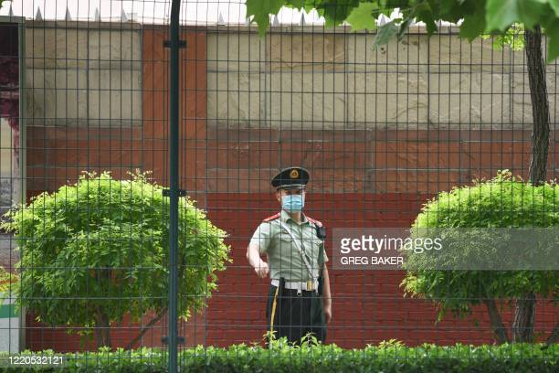 A Chinese paramilitary police officer stand s guard outside the Indian embassy in Beijing on June 17 2020 Beijing's state media on June 17 played...