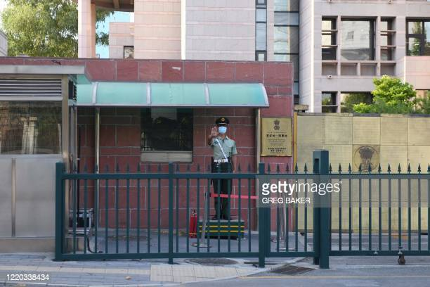A Chinese paramilitary police officer stands guard at an entrance to the Indian embassy in Beijing on June 16 2020 China on June 16 accused India of...