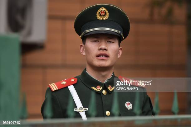 A Chinese paramilitary police officer stands guard outside the North Korean embassy in Beijing on March 28 2018 North Korean leader Kim Jong Un was...