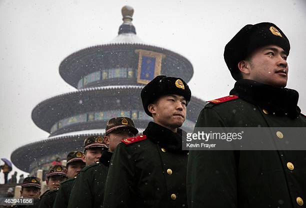 Chinese paramilitary police officers line-up during a light snowfall while guarding at the Temple of Heaven during Spring Festival celebrations on...