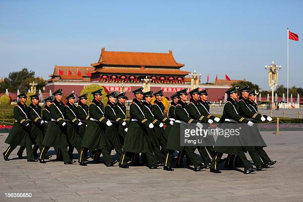 Chinese paramilitary police officers march after the closing session of the 18th National Congress of the Communist Party of China at the Tiananmen...