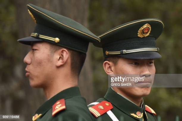 Chinese paramilitary police officers stand guard outside the North Korean embassy in Beijing on March 28 2018 North Korean leader Kim Jong Un was...