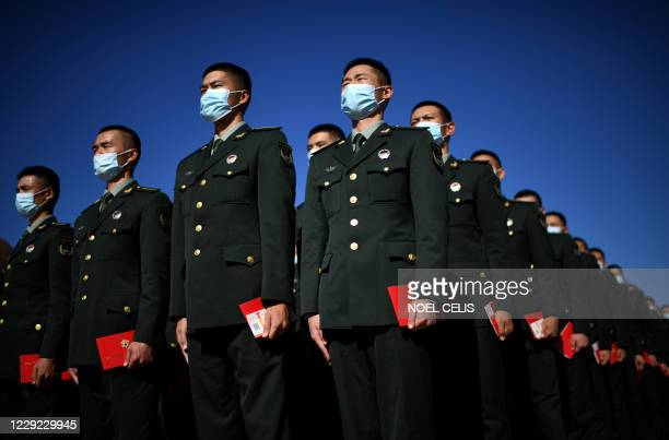 Chinese paramilitary police officers stand in formation outside the Great Hall of the People after the ceremony to commemorating the 70th anniversary...