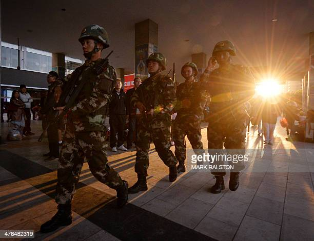Chinese paramilitary police patrol outside the scene of the attack at the main train station in Kunming, Yunnan Province, on March 3, 2014....