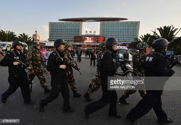 Chinese paramilitary police patrol outside the scene of the terror attack at the main train station in Kunming, Yunnan Province, on March 3, 2014....