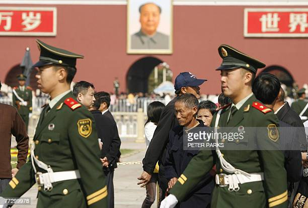 Chinese paramilitary police patrol Tiananmen Square in Beijing, 12 October 2007, ahead of the 17th National Congress of the Communist Party of China....