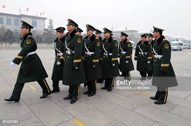 Chinese paramilitary police prepare to march on Tiananmen Square in Beijing on March 4 2010 a day before the opening session of the National People's...