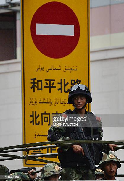 Chinese paramilitary police ride in trucks during a 'show of force' ceremony in Urumqi after a series of terrorist attacks recently hit Xinjiang...