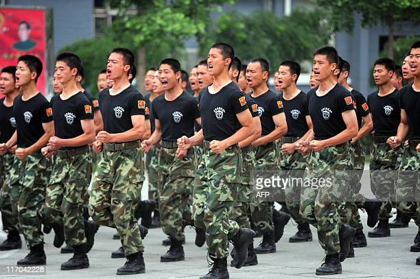 Chinese paramilitary police show off their skills in maintaining order at a demonstration in Beijing on June 16 2011 China sees thousands of protests...