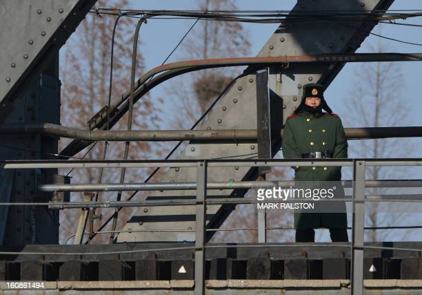A Chinese paramilitary policeman patrols the SinoKorean Friendship Bridge which leads to the North Korean town of Sinuiju on the banks of the Yalu...