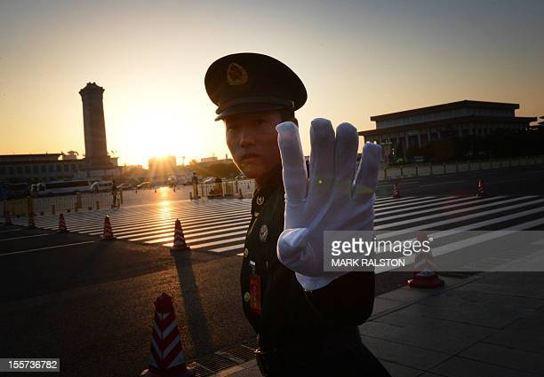 Chinese paramilitary policeman reacts outside the opening session of the Chinese Communist Party's five-yearly Congress at the Great Hall of the...