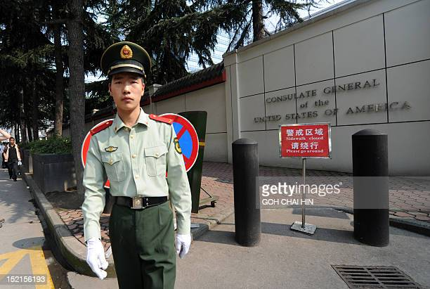 Chinese paramilitary policeman stands guard at the entrance of the US consulate in Chengdu, southwest China's Sichuan province on September 17 where...