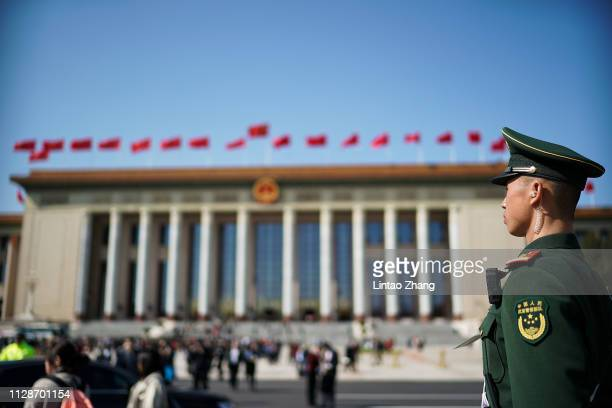 Chinese paramilitary policeman stands guard at Tiananmen Square during the opening session of the National People's Congress on March 5 2019 in...