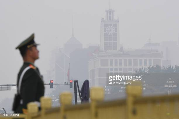 A Chinese paramilitary policeman stands guard in Tiananmen Square before the introduction of the Communist Party of China's Politburo Standing...