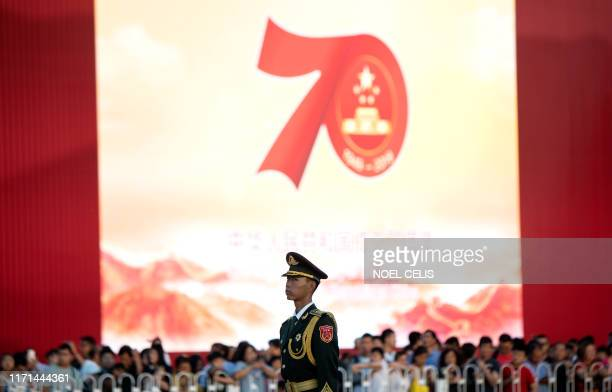A Chinese paramilitary policeman stands in formation near Tiananmen Gate in Beijing on September 27 2019 ahead of the 70th anniversary of the...