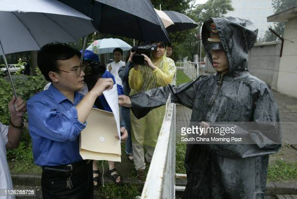A Chinese Paramilitary Policeman who is guarding the Japanese Embassy in Beijing China takes a look at a petition containing over 300000 signatures...