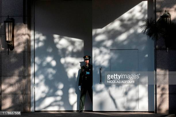 Chinese paramilitary soldier secures an entrance of Jingxi hotel in Beijing on October 28, 2019. - China's Communist Party elite kicked off a key...