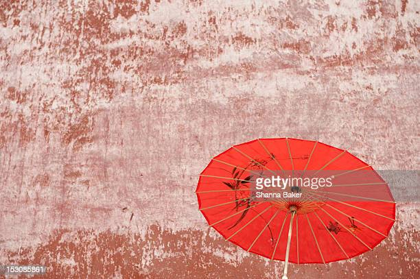Chinese parasol against a textured wall