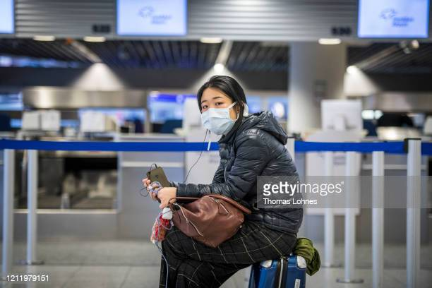 Chinese Passengers waits for check-in counter at Frankfurt Airport on March 12, 2020 in Frankfurt, Germany. U.S. President Donald Trump has announced...
