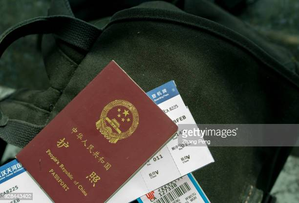 Chinese passport and air ticket on the baggage arranged for photography In 2017 the outbound tourists of Chinese nationality broke through 130...