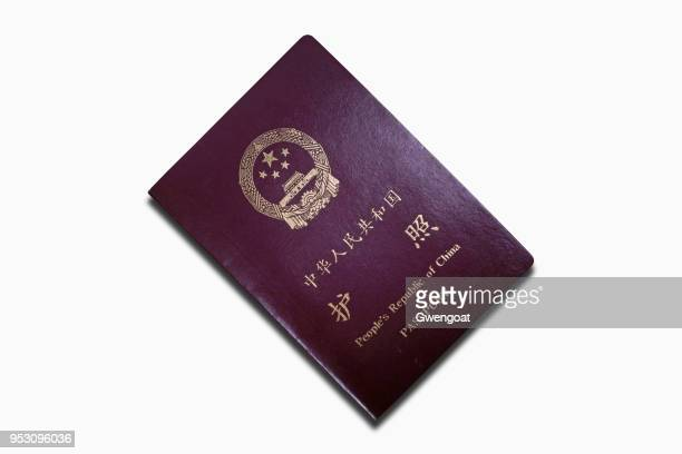 chinese passport isolated on a white background - gwengoat stock pictures, royalty-free photos & images