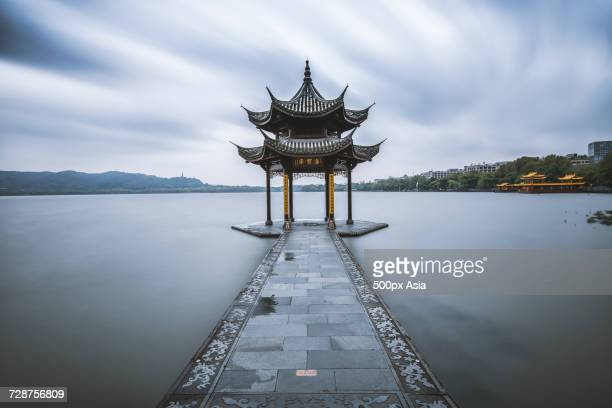 chinese pavilion on lake, guiyang, guizhou, china - guiyang stock pictures, royalty-free photos & images