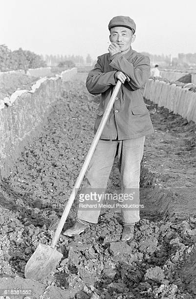 Chinese Peasant Leaning on Shovel