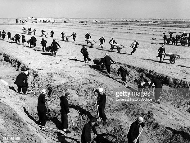 Chinese peasants farming on a communal farm in the 1950's during the 'Great Leap Forward'