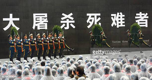 Chinese people and armed police attend the state memorial ceremony for the Nanjing Massacre at Nanjing Massacre Memorial Hall on December 13 2016 in...