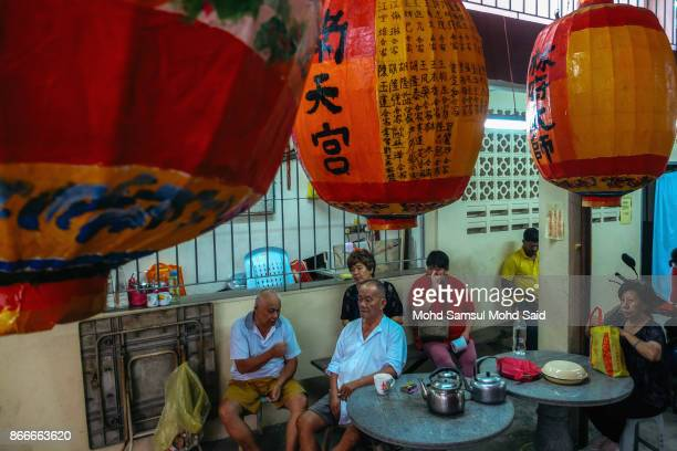Chinese people are seen as they wait for prayer during The Nine Emperor Gods Festival inside the temple on October 26 2017 in Kuala Lumpur Malaysia...
