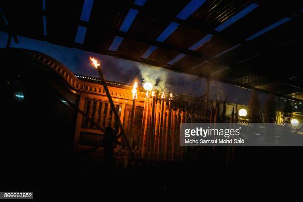 Chinese people burn a joss stick during The Nine Emperor Gods Festival inside the temple on October 26 2017 in Kuala Lumpur Malaysia The Nine Emperor...