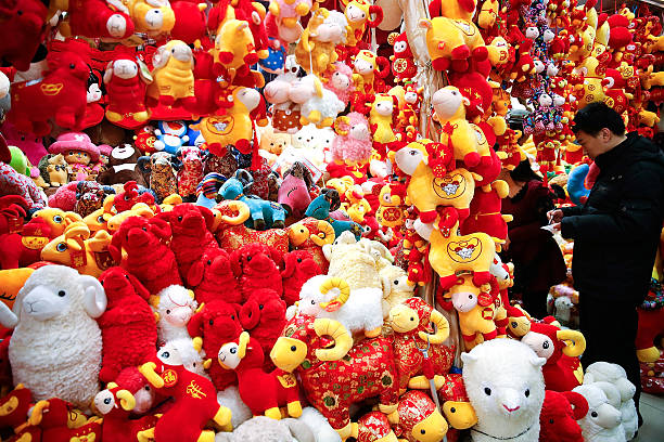 chinese people buy decorations for the upcoming chinese lunar new year of the sheep on february - Chinese Lunar New Year
