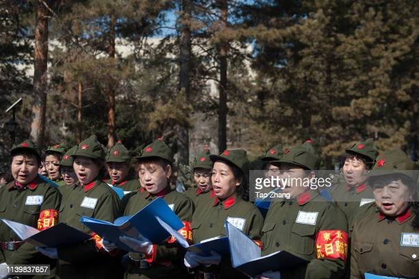 Chinese people dress military cloths to make a vow as they mourn for dead revolutionary martyrs to mark the Tomb Sweeping Day on April 2 2019 in...