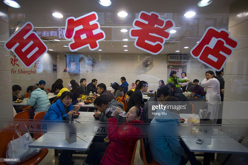Chinese people eat food in a century old restaurant in Nanjing Road Walking Street on February 3, 2013 in Shanghai, China.