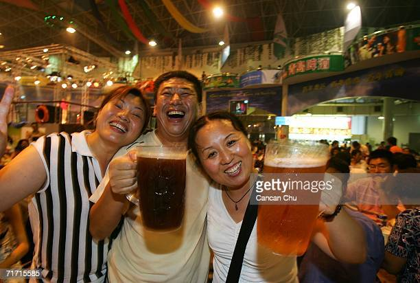 Chinese people enjoy beer during the beer festival on August 23 2006 in Qingdao Shandong Province of China Tsingtao Beer Group China's biggest beer...