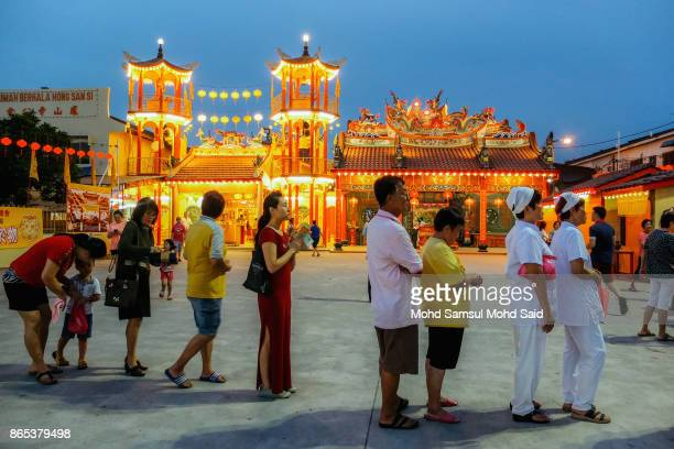 Chinese people lineup as they wait their turn to perform prayer during The Nine Emperor Gods Festival inside the temple on October 23 2017 in Klang...