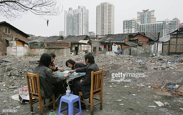 Chinese people play mahjong at a demolition site in Dacisi Area on March 6 2005 in Chengdu of Sichuan Province China The Dacisi Area is an old...