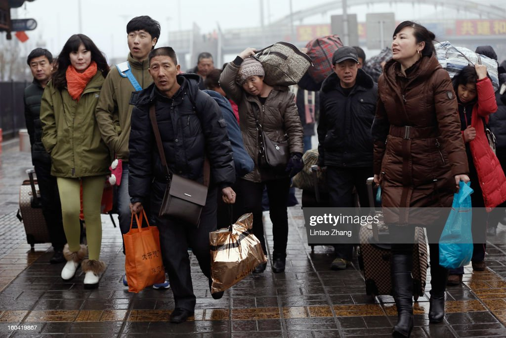 Chinese people prepare to travel at the Beijing Railway Station on January 31, 2013 in Beijing, China. The Spring Festival travel season runs from January 26 to March 6 and according to reports road passenger transport in China is estimated at 3.1 billion people during this time of year.