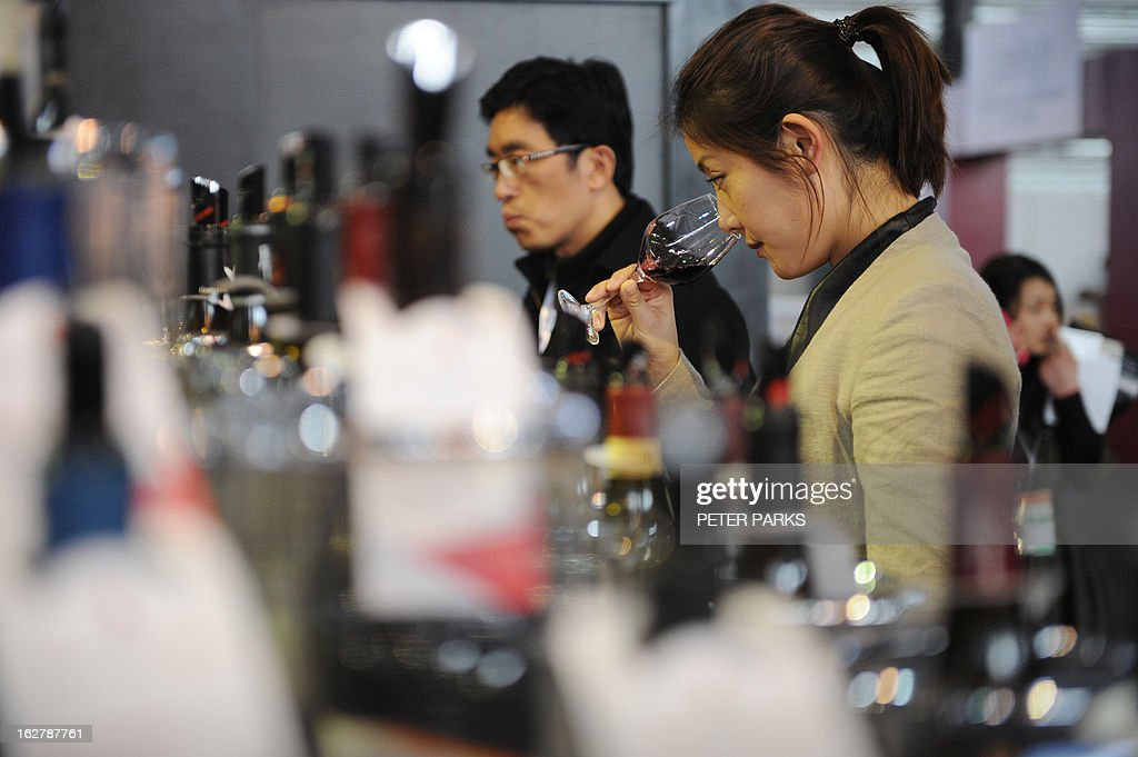 Chinese people sample wine at the VINISUD, the world's leading Mediterranean wines fair being held in Shanghai on February 27, 2013. With average consumption of just one litre per person per year, China may not have an age-old wine tradition, but it is catching up fast and is expected to become the world's sixth largest wine consumer by 2014. AFP PHOTO/Peter PARKS